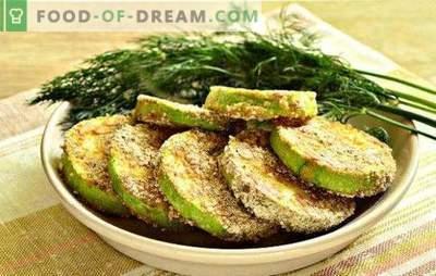Courgette in knoflookbeslag - een hartige snack. Courgette gebakken in een pan met knoflook in zure room, bier, kefir en eierbeslag