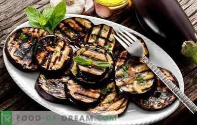 Aubergine op de grill - een gezonde snack, een smakelijk bijgerecht. Salades en snackgerechten met gegrilde aubergine