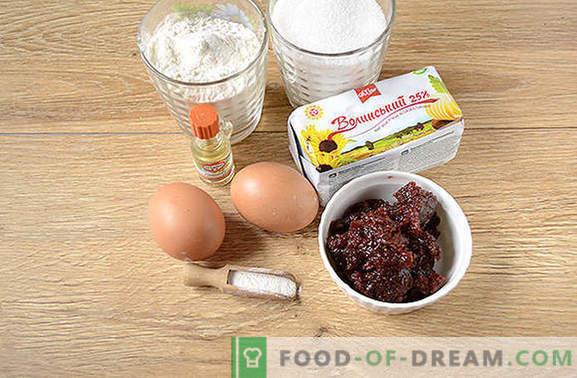 Geraspte jamtaart is een snelle verrassing in de ochtend. Stapsgewijs foto-recept van kruimelige zandtaart met confituur op margarine